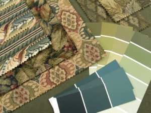 A blueish green print interior design plan color cards and textile samples.