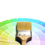 A photo of a paintbrush and swatches